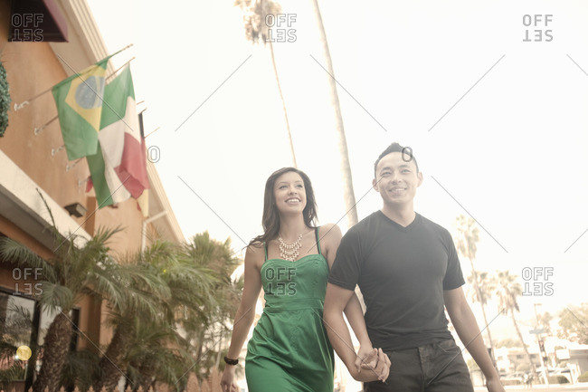 Couple strolling and holding hands on street