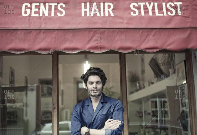 Man in barbershop doorway