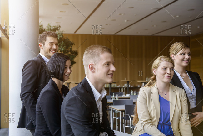 Businesswomen and men listening at business meeting in office