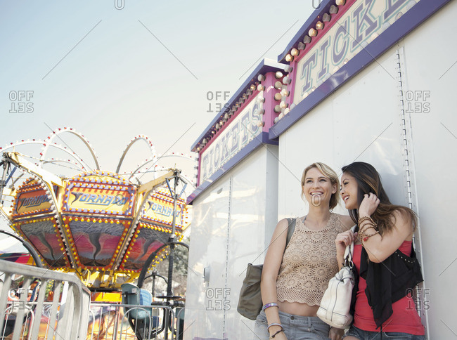Los Angeles, california, USA - March 24, 2013: Two women at fairground, smiling and watching surroundings
