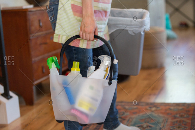 Young woman cleaning home with green cleaning products
