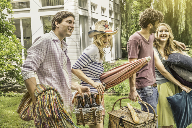 Friends preparing for picnic in garden