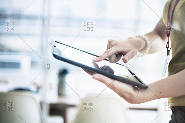 Woman using digital tablet at office
