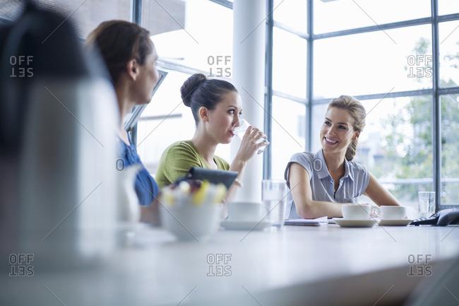 Colleagues talking in meeting room