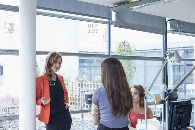 Three businesswomen discussing ideas at informal meeting