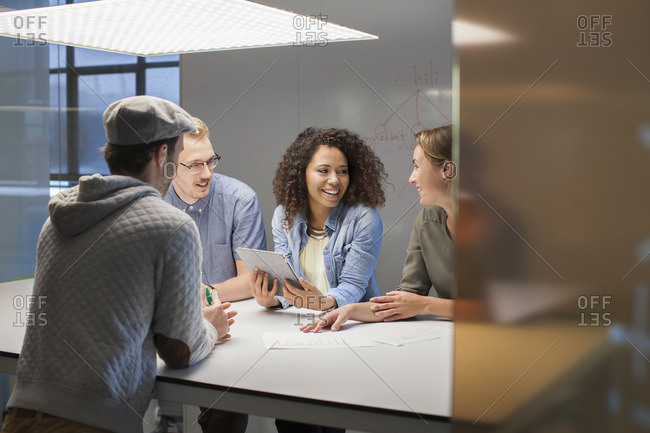 Four creative colleagues meeting at conference table