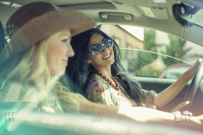 Two female friends on car journey together