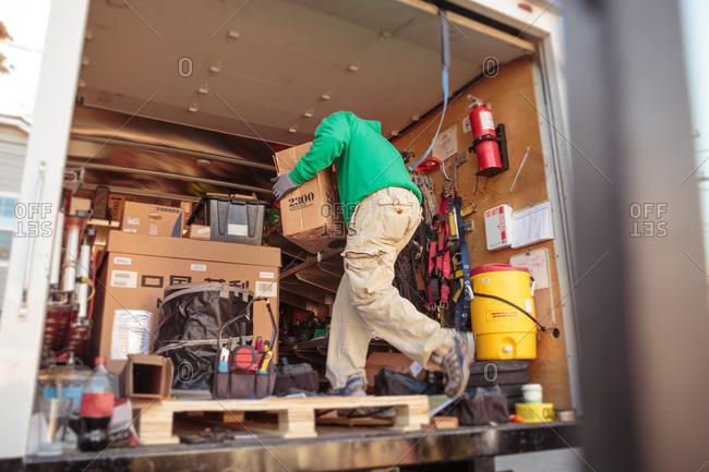 Solar panel installation crew member in truck