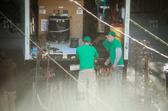 Solar panel installation crew by truck