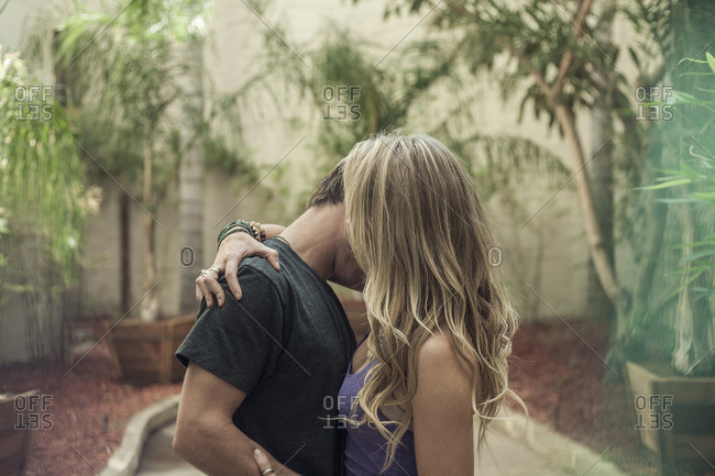 Young romantic couple, kissing, outdoors