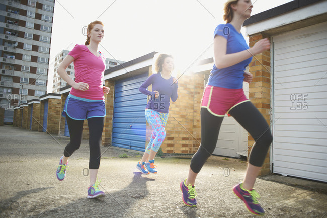 Three women exercising and jogging together