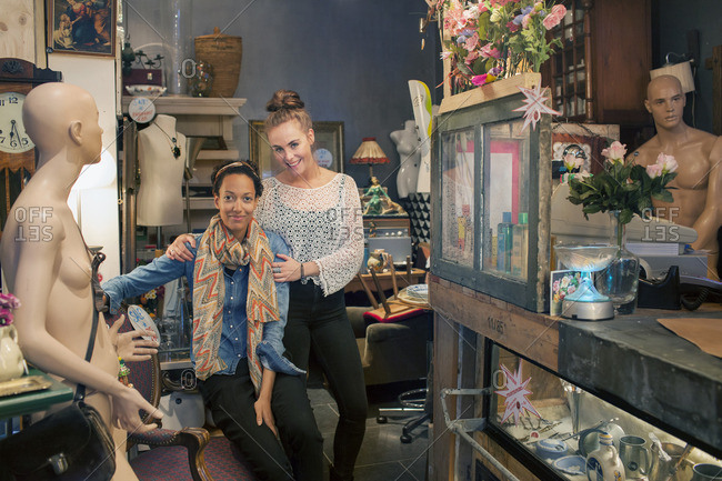 Portrait of two female colleagues in vintage shop