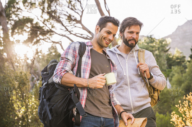 Two male hikers preparing for hike in forest, Deer Park, Cape Town, South Africa