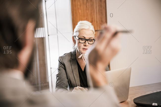 View over shoulder of businesswoman in meeting