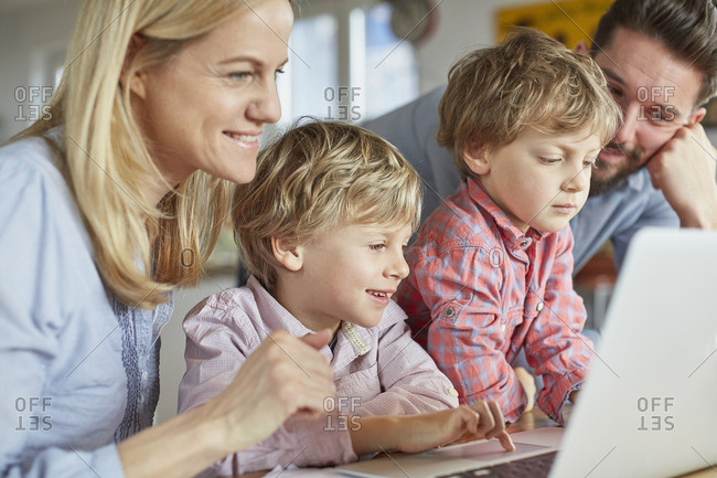Parents and sons using laptop