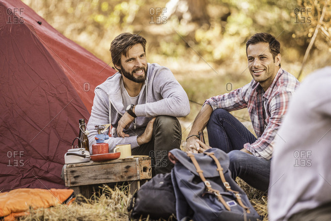 Men camping together in forest, Deer Park, Cape Town, South Africa