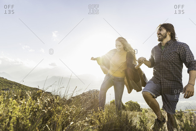 Couple taking walk on sunny day, Franschhoek, South Africa