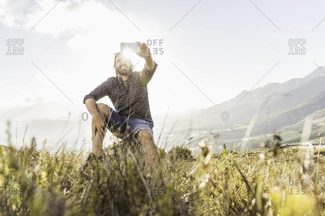 Man taking selfie on sunny day, Franschhoek, South Africa