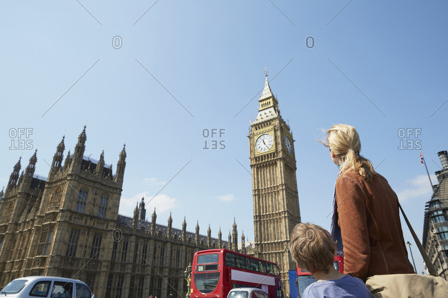 Rear view of mother and son looking at big ben