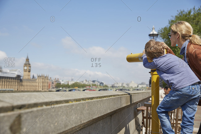 Mother and son using coin operated binoculars