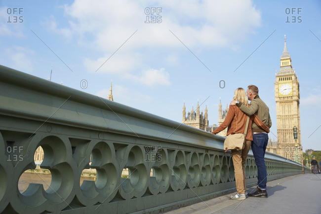 Couple on Westminster bridge looking at view