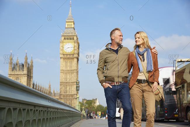 Couple walking on Westminster bridge
