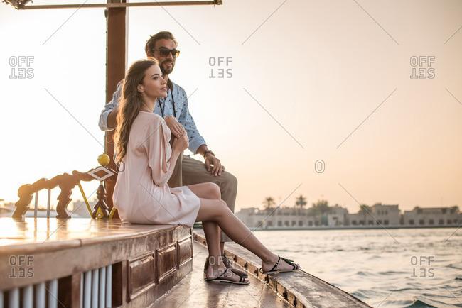 Romantic couple watching from boat at Dubai marina, United Arab Emirates
