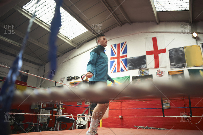 Boxer skipping in boxing ring, low angle view