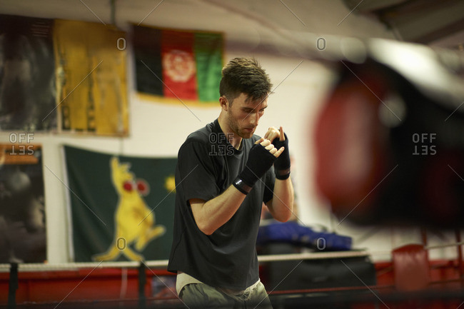 Boxer practicing in boxing ring