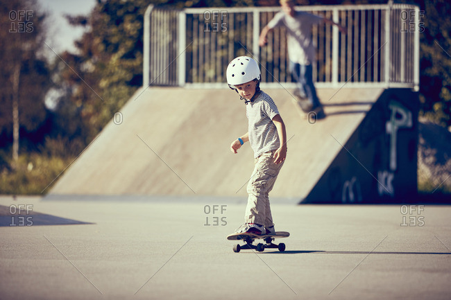 Boy skateboarding in park