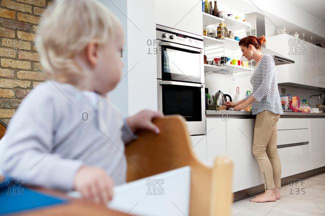 Mother preparing son's food