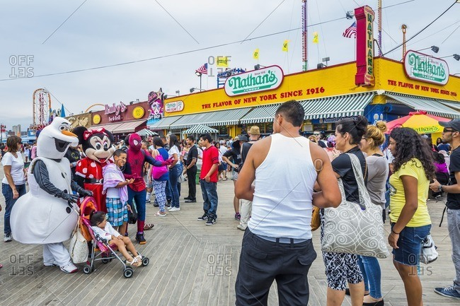 Coney Island, Brooklyn: taking photos with costumed characters near Nathan's Famous