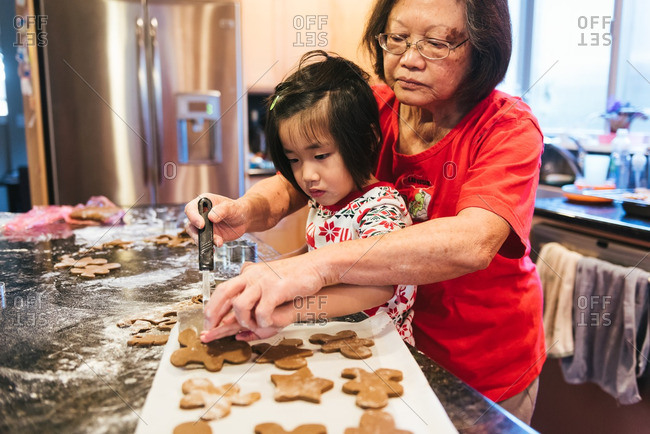 Girl and woman making traditional cookies