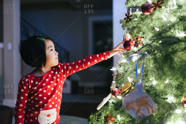 Girl in glow from Christmas tree