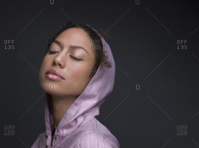 Mixed Race woman wearing hooded shirt