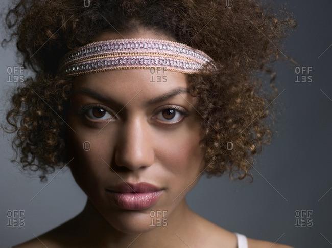 Mixed Race woman wearing headband
