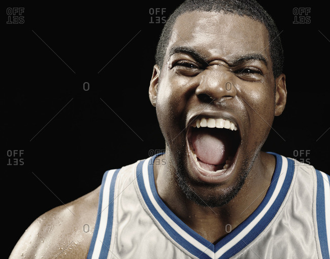 African basketball player shouting