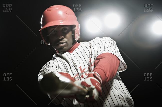 African baseball player swinging bat