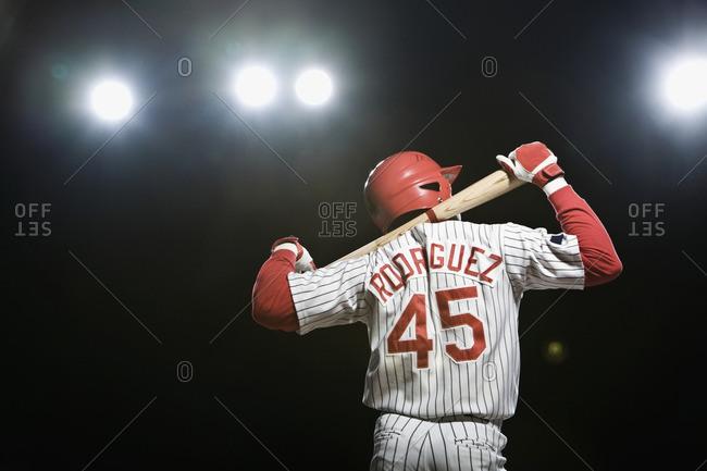 African baseball player holding bat