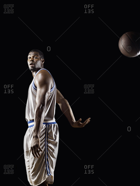 African basketball player passing basketball