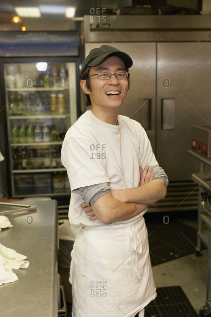 Japanese chef smiling with arms crossed