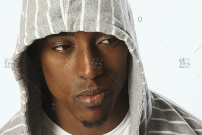 African man wearing hooded shirt