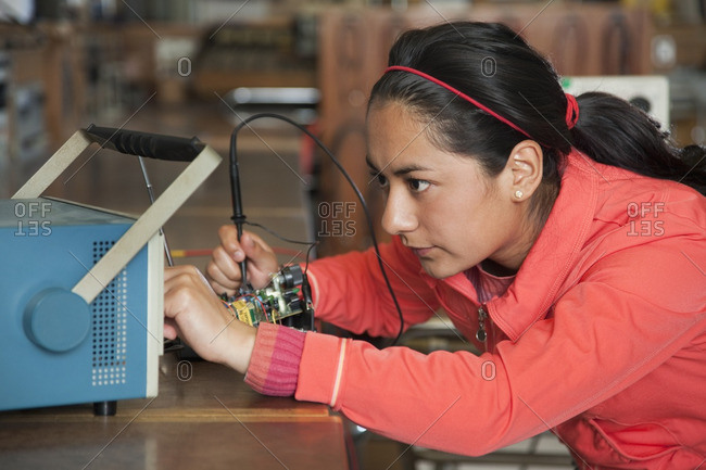 Hispanic woman working in electronics lab