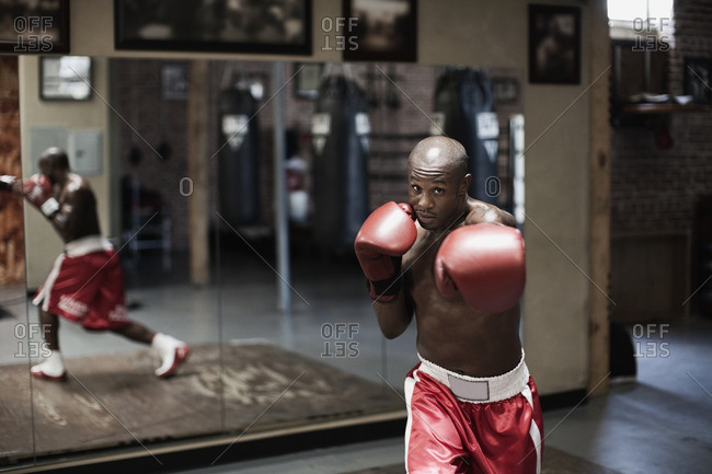 African boxer training in gym