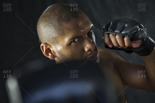 Hispanic boxer warming up