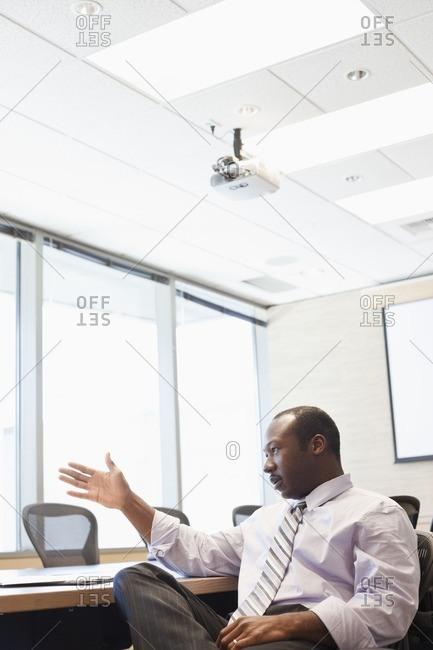 Black businessman talking in conference room