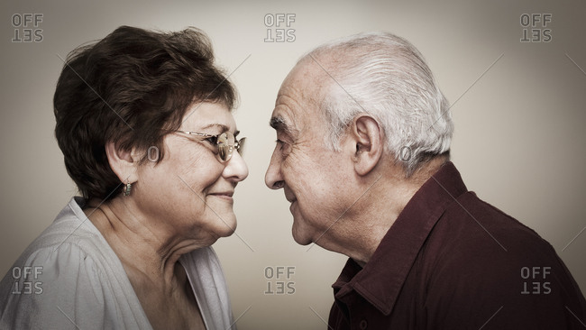 Senior Hispanic couple face to face