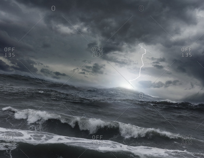 Lightning striking ocean water
