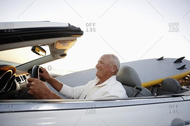 Caucasian man driving convertible