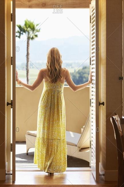 Woman standing in doorway looking out